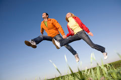 Happy smiling couple  jumping Royalty Free Stock Images