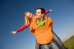 Happy smiling couple jumping in blue sky Royalty Free Stock Photo