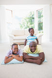 Happy smiling couple lokking at camera with their daugther Stock Images