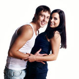 Happy smiling couple in love. Over white background Royalty Free Stock Photos