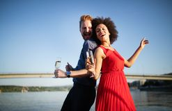 Happy smiling couple in love dancing and flirting. Outdoor stock photo