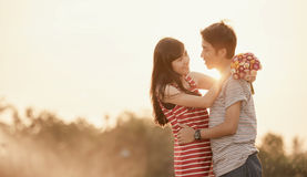Happy Smiling Couple. In love at twilight royalty free stock image