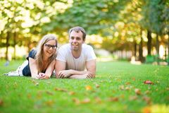 Happy smiling couple lying on the grass Royalty Free Stock Images