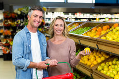 Happy smiling couple picking lemon Stock Images
