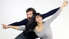 Happy smiling couple pretending to fly Royalty Free Stock Photos