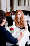 Happy smiling couple in restaurant celebrate Royalty Free Stock Image