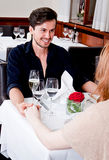 Happy smiling couple in restaurant celebrate Stock Photography