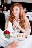 Happy smiling couple in restaurant celebrate Stock Photos