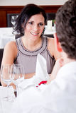 Happy smiling couple in restaurant celebrate Royalty Free Stock Images