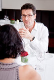 Happy smiling couple in restaurant celebrate Stock Images