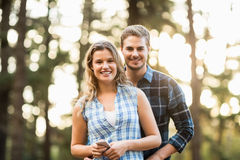 Happy smiling couple standing behind each other Royalty Free Stock Photo