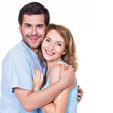 Happy smiling couple standing together. Happy smiling couple standing together looking at camera - isolated on white background royalty free stock images