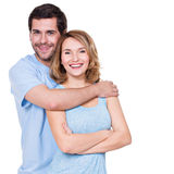Happy smiling couple standing together. Royalty Free Stock Photography