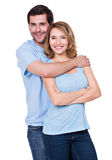 Happy smiling couple standing together. Happy smiling couple standing together looking at camera - isolated on white background stock image