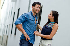 Happy smiling couple in urban background Royalty Free Stock Photo