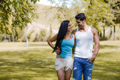 Happy smiling couple in urban park stock image