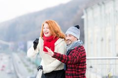 Happy smiling couples pointing to city sight. Funny couple indicating to left. Man with girlfriend on bridge enjoying travel stock images