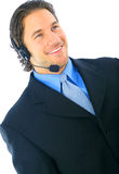 Happy Smiling Customer Service. Handsome young adult wearing headset and smile. isolated on white Royalty Free Stock Image