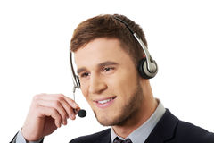 Happy smiling customer support phone operator. Handsome happy smiling customer support phone operator Royalty Free Stock Photos