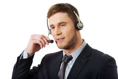 Happy smiling customer support phone operator. Handsome happy smiling customer support phone operator royalty free stock photo