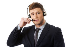 Happy smiling customer support phone operator. Handsome happy smiling customer support phone operator Stock Photos
