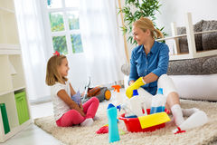 Happy smiling cute daughter and mom cleaning home Royalty Free Stock Photos
