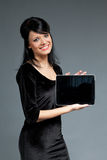 Happy smiling cutie with touch pad empty screen stock images