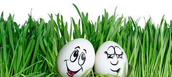 Happy smiling easter eggs on a white background Stock Photos