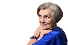 Happy smiling elder woman in elegant dress Stock Image