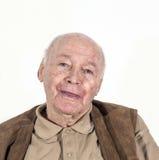 Happy smiling elderly retired man. Portrait of elderly retired man isolated on white Royalty Free Stock Photos