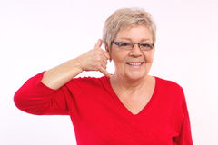 Happy smiling elderly woman making call me gesture, human emotions, facial expressions Royalty Free Stock Photos