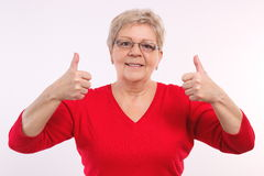 Happy smiling elderly woman showing thumbs up, positive emotions in old age Royalty Free Stock Image
