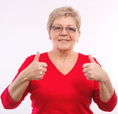 Happy smiling elderly woman showing thumbs up, positive emotions in old age. Happy smiling elderly woman showing thumbs up, approval of offer or situation Stock Images