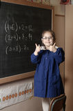 Happy smiling elementary school girl first-grader shows thub u Royalty Free Stock Photos