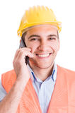Happy smiling engineer talking on smartphone Stock Images
