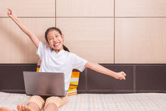 Happy smiling and excited asian girl using computer laptop noteb Stock Photo