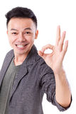 Happy, smiling, exited man giving ok hand gesture Stock Photos