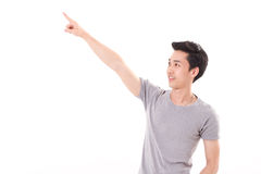 Happy, smiling, exited man pointing finger up, white isolated Stock Photo