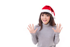 Happy, smiling, exited woman wearing X'mas santa hat, grey sweat Stock Photo