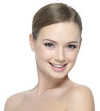 Happy smiling face of the young teen girl. Happy smiling face of young beautiful teen girl with clean skin - isolated on white royalty free stock image