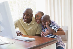 Happy smiling family chatting with computer Royalty Free Stock Image
