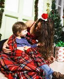 Happy smiling family on Christmas at house with gifts, young mot Royalty Free Stock Images