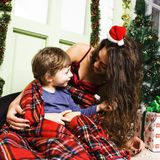 Happy smiling family on Christmas at house with gifts, young mot Royalty Free Stock Photography