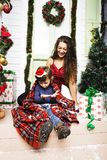 Happy smiling family on Christmas at house with gifts, young mot Stock Photo
