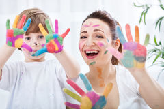Happy smiling family with colorful hands Royalty Free Stock Images