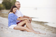 Happy smiling family couple of slim fit beautiful brunette mothe Royalty Free Stock Photo