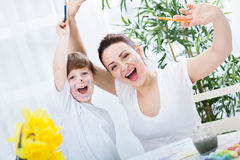 Happy smiling family finish drawing success Royalty Free Stock Image