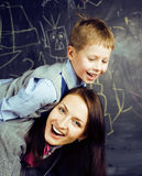 Happy smiling family having fun in classroom at blackboard, mother with son, lifestyle people concept. Close up Royalty Free Stock Photo