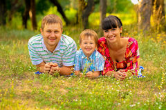 Happy smiling family on the lawn Stock Images