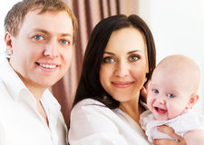 Happy smiling family with little baby girl Royalty Free Stock Photo